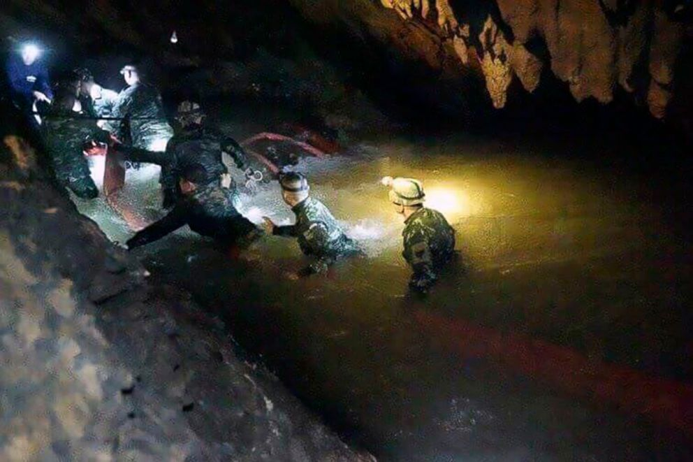 Rescue teams walk inside cave complex where 12 boys and their soccer coach went missing, in Mae Sai, Chiang Rai province, in northern Thailand, July 2, 2018.