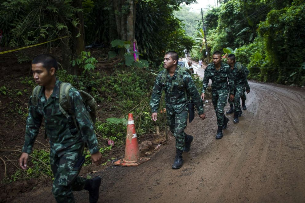 Thai soldiers make their way near the Tham Luang cave as rescue operations continue for the 12 boys and their coach trapped in the cave at the Khun Nam Nang Non Forest Park in Chiang Rai, Thailand, July 6, 2018.