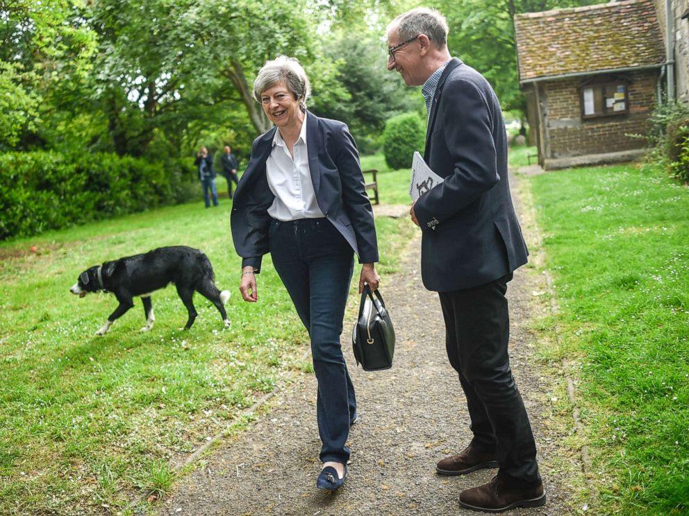 PHOTO: British Prime Minister Theresa May and her husband Philip May leave church, May 26, 2019, in Aylesbury, England.
