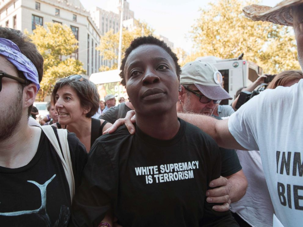 PHOTO: Therese Okoumou is surrounded by supporters as she leaves Federal court, Thursday, July 5, 2018, in New York.