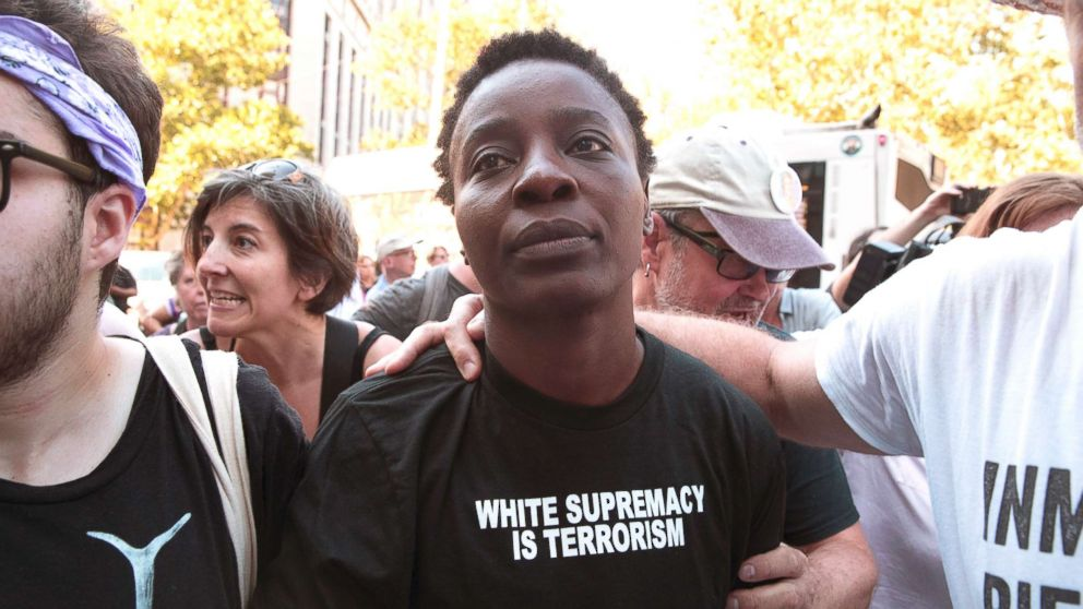 Therese Okoumou is surrounded by supporters as she leaves Federal court on July 5, 2018, in New York.