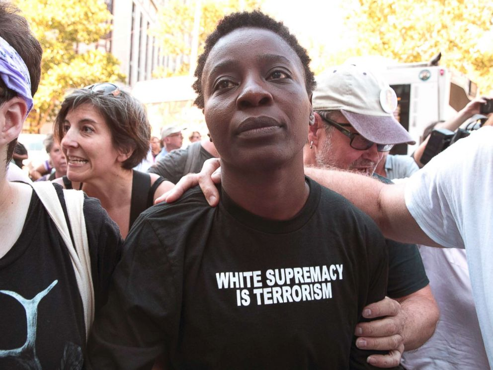 PHOTO: Therese Okoumou is surrounded by supporters as she leaves Federal court on July 5, 2018, in New York.