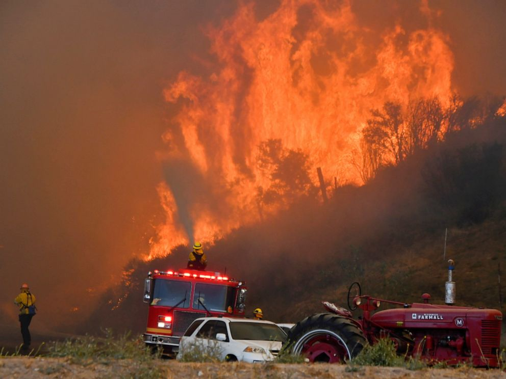 PHOTO: Firefighters arrive to battle the Tick fire, a wind driven wild fire in the hills of Canyon Country north of Los Angeles, Oct. 24, 2019.