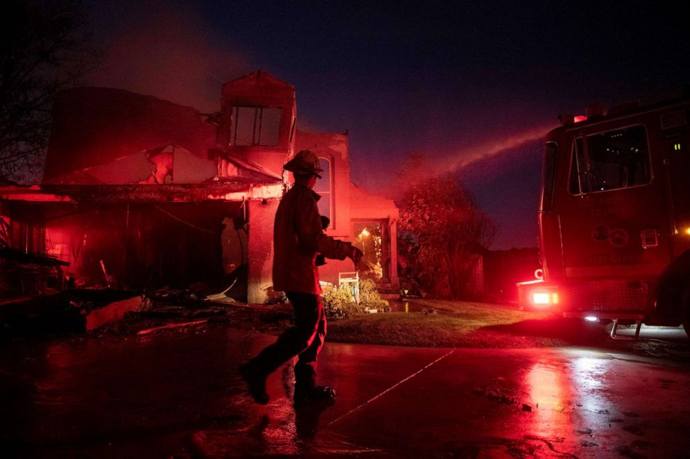 PHOTO: A firefighter assesses the damage of a home from the Tick Fire, Thursday, Oct. 24, 2019, in Santa Clarita, Calif.