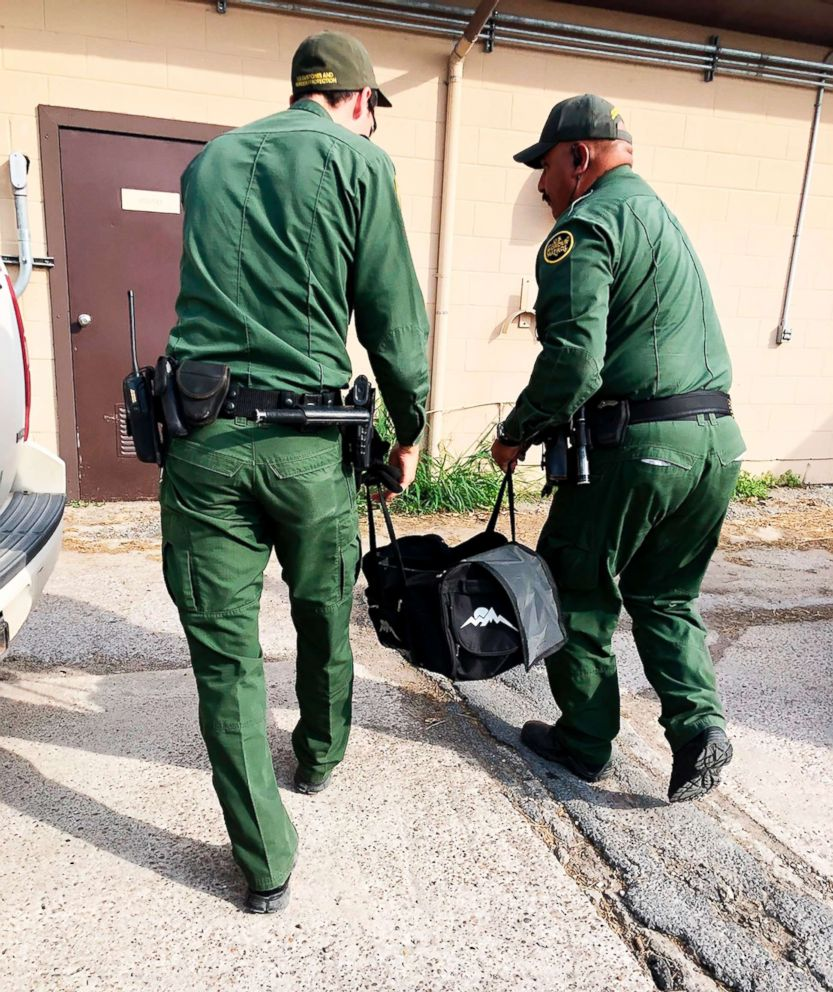 PHOTO: U.S Customs and Border Protection agents carrying a male tiger in a duffle bag that was seized at the border near Brownsville, Texas, into the the Gladys Porter Zoo in Brownsville, April 30, 2018.