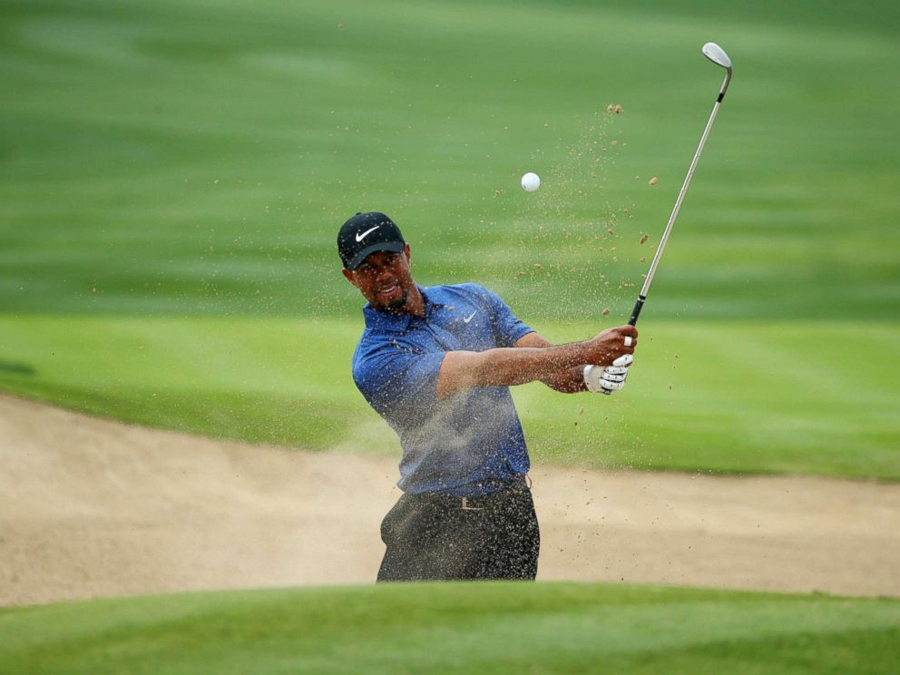 PHOTO: Tiger Woods plays from a bunker on the 6th hole during the first round of the Omega Dubai Desert Classic at Emirates Golf Club in this Feb. 2, 2017 file photo in Dubai.