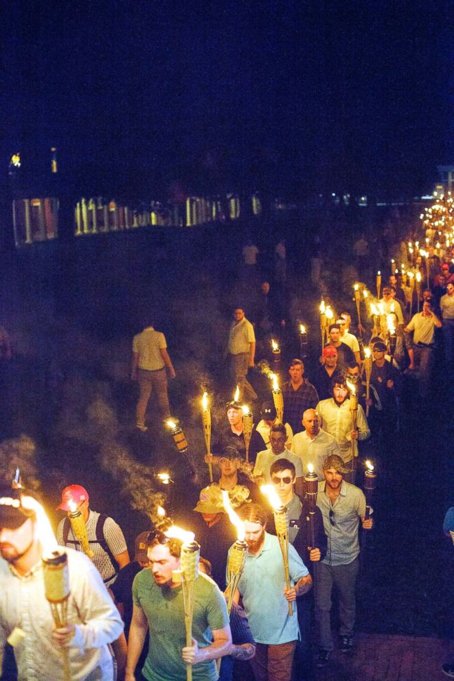 PHOTO: Neo Nazis and White Supremacists march the night before the Unite the Right rally in Charlottesville, Va., Aug. 12, 2017.