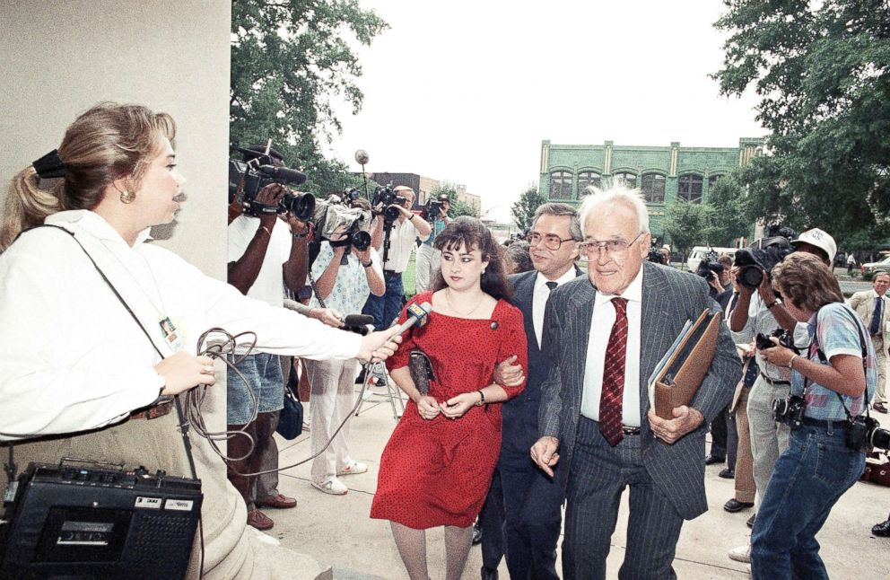 PHOTO: Former PTL leader Jim Bakker, center is flanked by members of the press as he arrives at the Federal Building in Charlotte, N.C., Aug. 22, 1989, with his daughter Tammy Sue Chapman and attorney for jury selection in his trial.