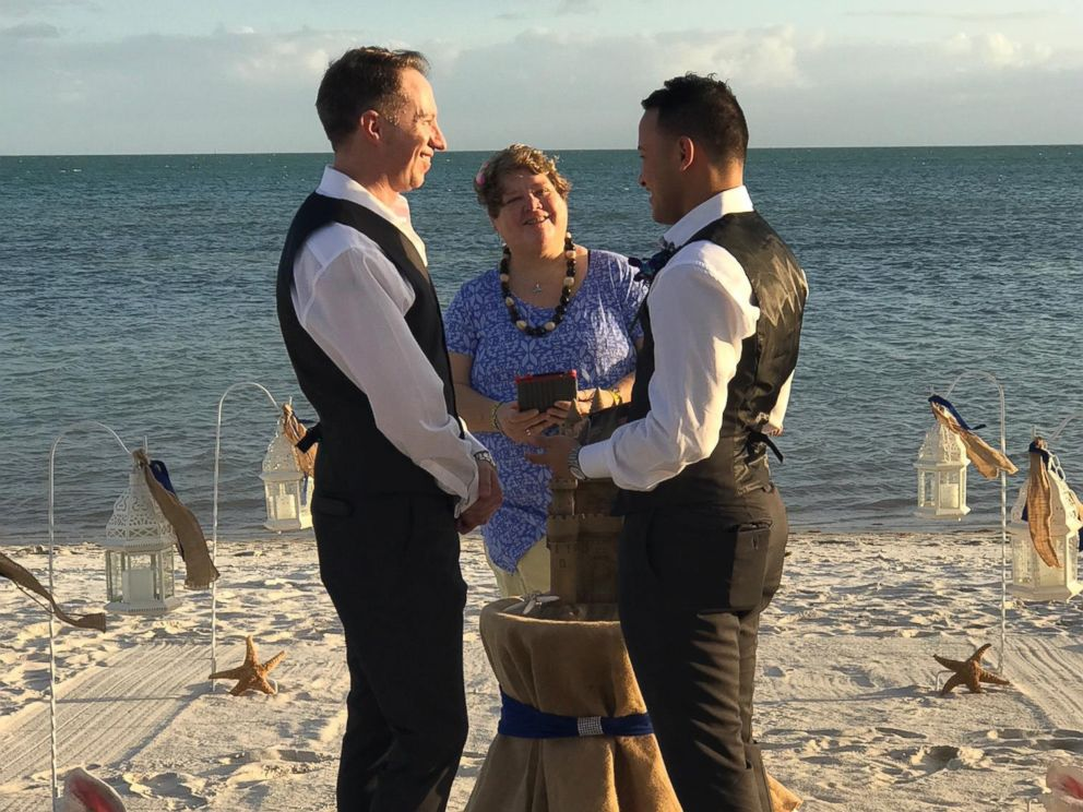 PHOTO: Army Chaplain Tim Brown of Sanford, N.C., left, marries his fiance, Sergio Avila, on the beach in January 2017.