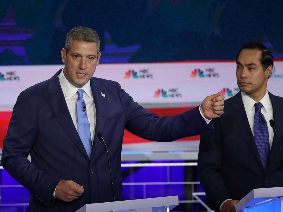 PHOTO: Rep. Tim Ryan speaks as former housing secretary Julian Castro looks on during the first night of the Democratic presidential debate on June 26, 2019, in Miami.