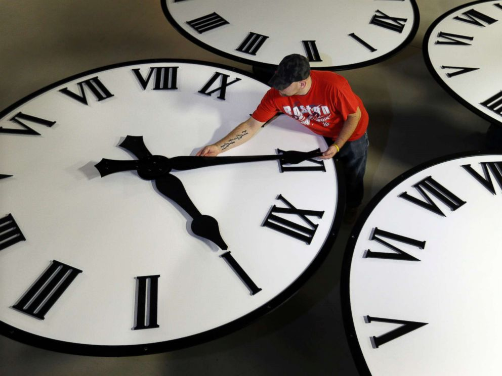 Elise Amendola  AP FILEDan La Moore sizes hands for an 8-foot diameter silhouette clock at Electric Time Co. in Medfield Mass. Nov. 3 2016