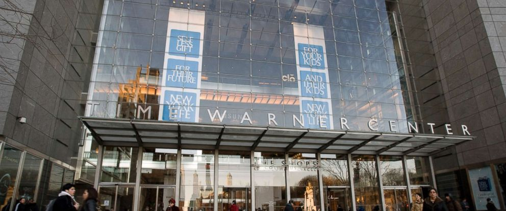 PHOTO: Pedestrians walk past the Time Warner Center, headquarters of Time Warner Inc., in New York, Feb. 4, 2009.