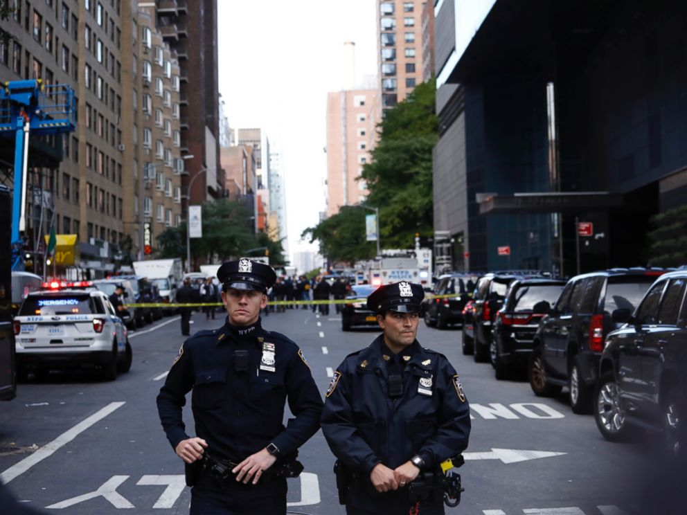 PHOTO: Police stand guard in a closed street after a bomb alert at the Time Warner offices in New York, Oct. 24, 2018.