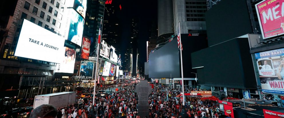 PHOTO: Screens in Times Square are black during a power outage, Saturday, July 13, 2019, in New York.