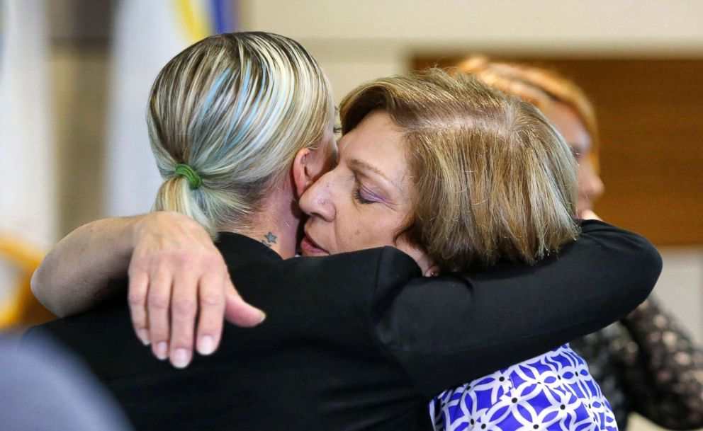 PHOTO: Tina Franke, right, the mother of murder victim Christine Franke, gets a hug from Christines niece, Ashley, after a press conference, Nov. 5, 2018, at Orlando Police Department headquarters announcing the solving of the cold case from 2001.