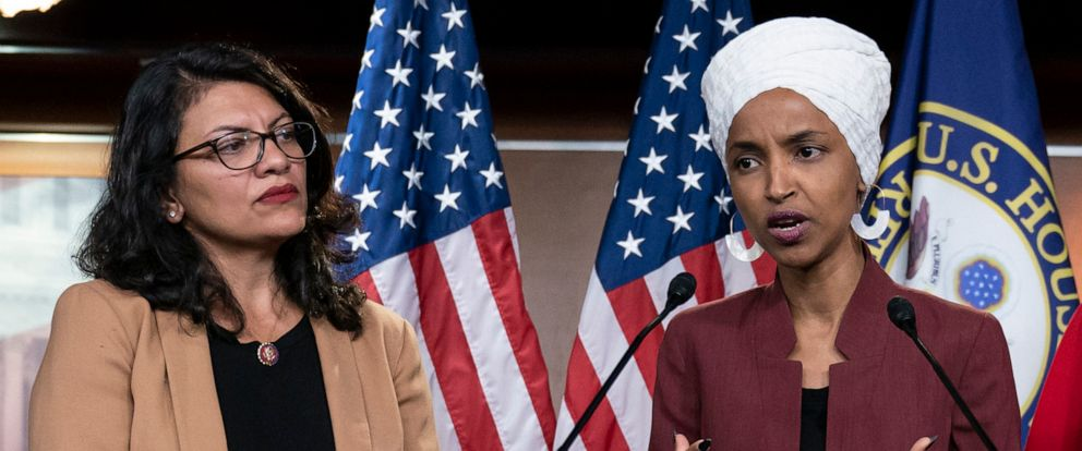 PHOTO: Rep. Ilhan Omar, right, speaks, as Rep. Rashida Tlaib listens, during a news conference at the Capitol in Washington, July 15, 2019.
