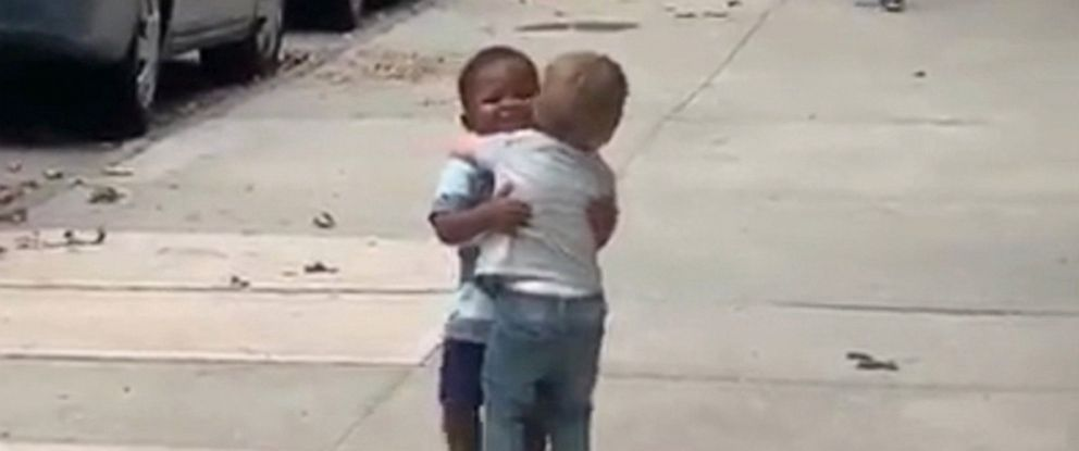 PHOTO: Two-year-old best friends, Finnegan and Maxwell, embrace on the street in this screen grab from viral video.