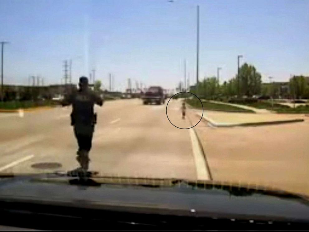 Police officer rescues toddler running along highway