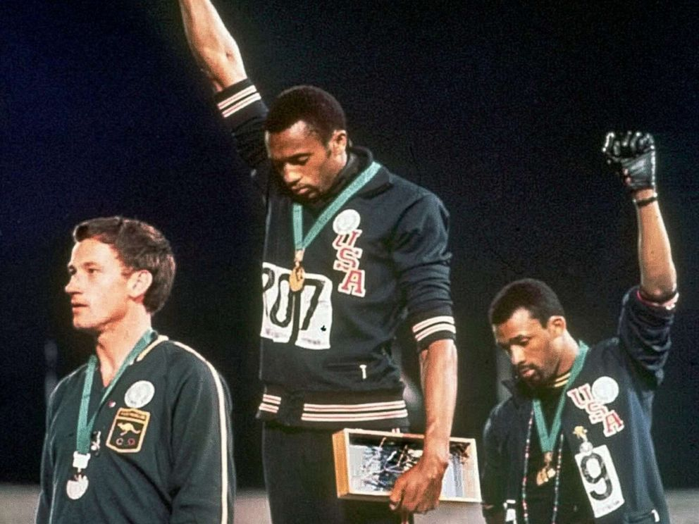 PHOTO: Athletes Tommie Smith, center, and John Carlos stare downward during the playing of The Star-Spangled Banner after Smith received the gold and Carlos the bronze medal in the 200 meter run at the Summer Olympic Games in Mexico City.