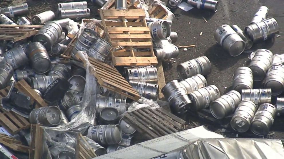 PHOTO: Hundreds of empty beer kegs and containers littered I-95 in Bensalem, Bucks County, PA, April 10, 2018, after a trucked plunged more than 20 ft.