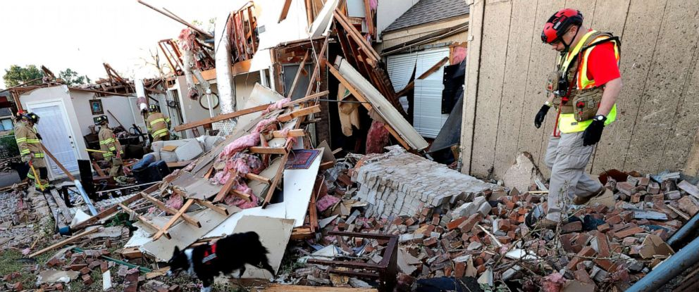 PHOTO: A search and rescue team checks a home after a tornado hit the neighborhood in Richardson, Texas, Oct. 21, 2019.