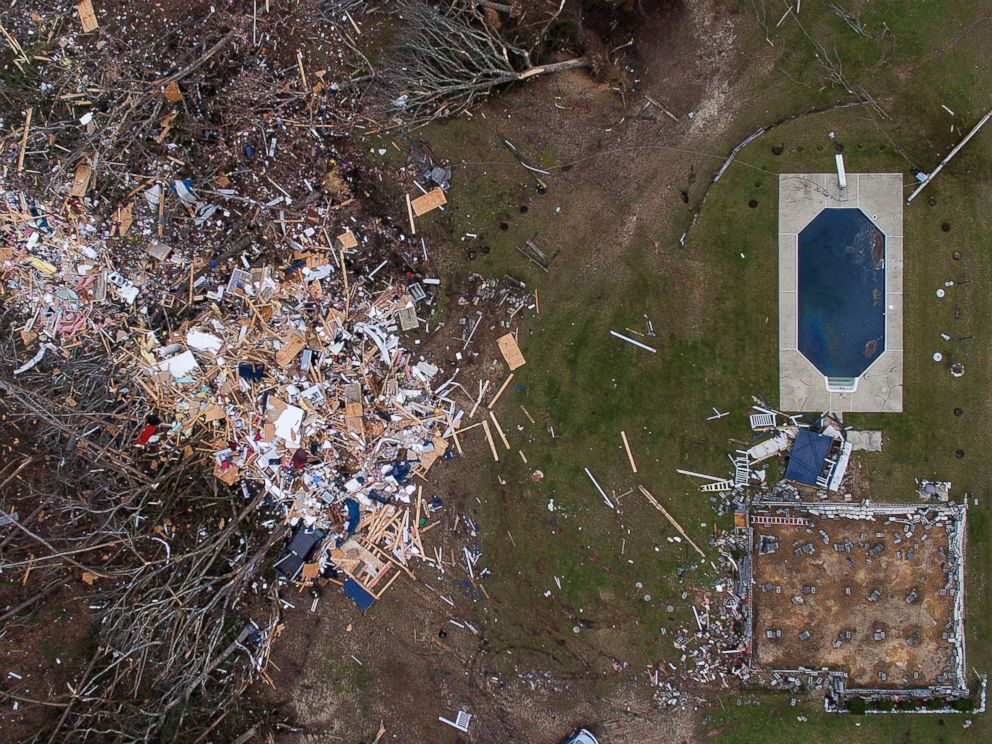PHOTO: Debris from a home litters a yard the day after a tornado blew the building off its foundation, lower right, in Beauregard, Ala., March 4, 2019.