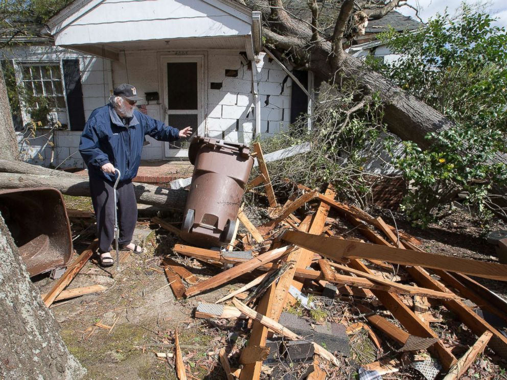 PHOTO: David Oldham, on Oak Grove Avenue, stands amid wreckage the day after a tornado sent a tree crashing into his house, April 16, 2018, in Greensboro, N.C.