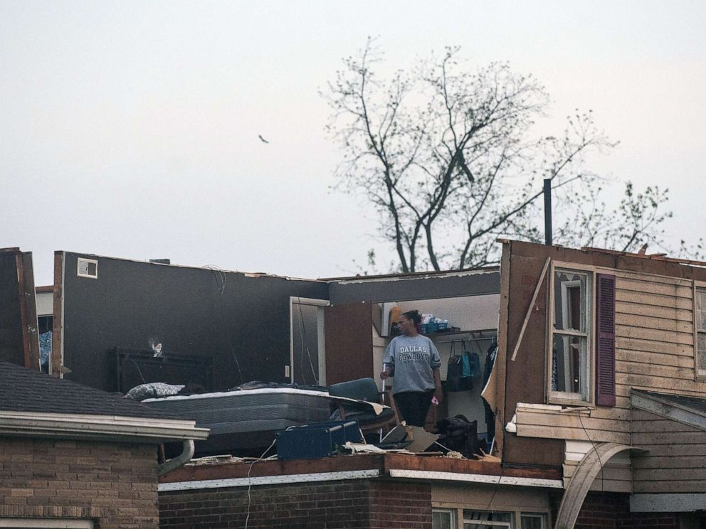 PHOTO: Residents of the Trotwood neighborhood West Brook inspect the damage to their homes following powerful tornado, May 28, 2019, in Trotwood, Ohio.