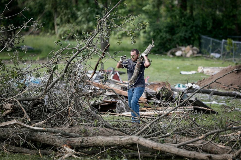 PHOTO: Residents and volunteers help clear debris from damaged homes resulting from a tornado storm system, May 28, 2019, in Brookville, Ohio.