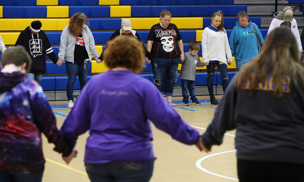 PHOTO: Students, teachers and residents hold a prayer circle in the gymnasium of Beauregard High School for those in their community that lost their lives in a Sunday night tornado on Monday, March 4, 2019, in Beauregard, Ala.