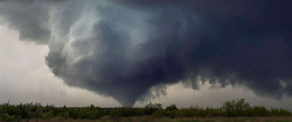 PHOTO: A collar cloud and cone tornado pictured on May 18, 2017 in Waynoka, Oklahoma.