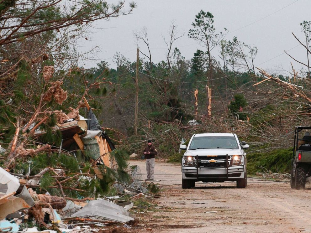 PHOTO: Damage from a tornado is seen as Lee county deputies secure the scene in Beauregard, Ala., March 4, 2019.