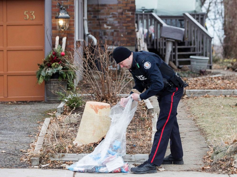 PHOTO: A police officer investigates outside a house on Mallory Crescent in Toronto, Jan. 29 , 2018.