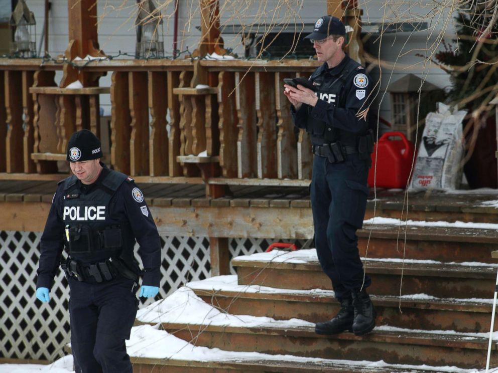 PHOTO: Toronto police forensic officers walk outside a house in Madoc, Ontario in this Jan. 19, 2018 file photo.