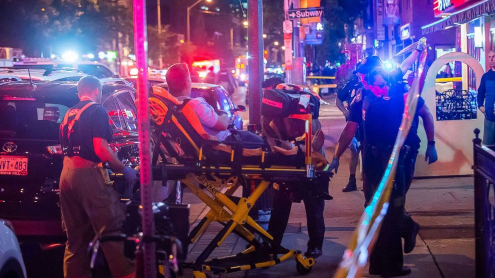 A man is transported in a stretcher after a shooting in Toronto on the evening of July 22, 2018.