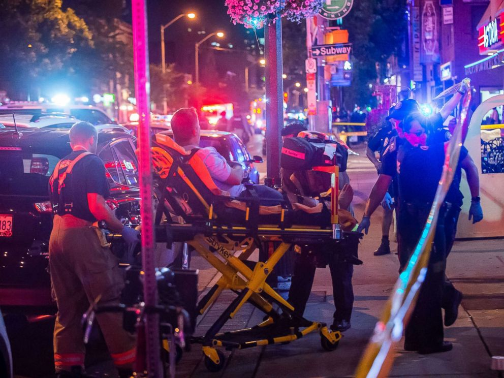 PHOTO: A man is transported in a stretcher after a shooting in Toronto on the evening of July 22, 2018.
