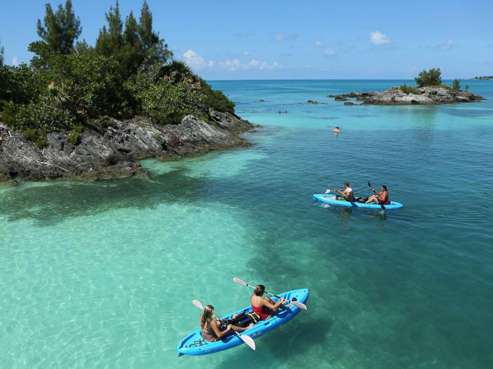 PHOTO: Tourists kayak in clear waters near a reef offshore from Hamilton, Bermuda, July 15, 2013.