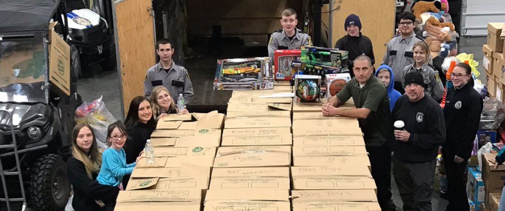 PHOTO: Coeur dAlene police officers, detectives and youth outreach members stand with boxes of donated toys packed for delivery on Dec. 18, 2018.