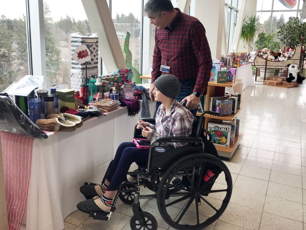 PHOTO: Patient Averie Green looks at toys in the Santa Store at Sacred Heart Childrens Hospital in Spokane, Wash., Dec. 20, 2018.
