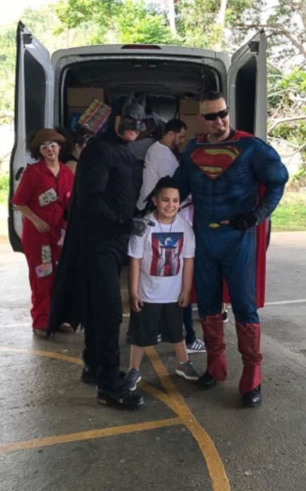 PHOTO: In Arecibo, Puerto Rico, characters also came to entertain the children as Jayden Perez, his family as well as a priest in Puerto Rico handed out toys and goodies.