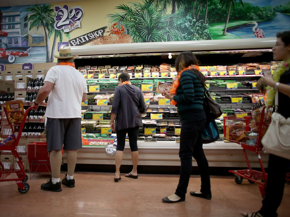 PHOTO: Shoppers attend the grand opening of a Trader Joes on Oct. 18, 2013, in Pinecrest, Fla.