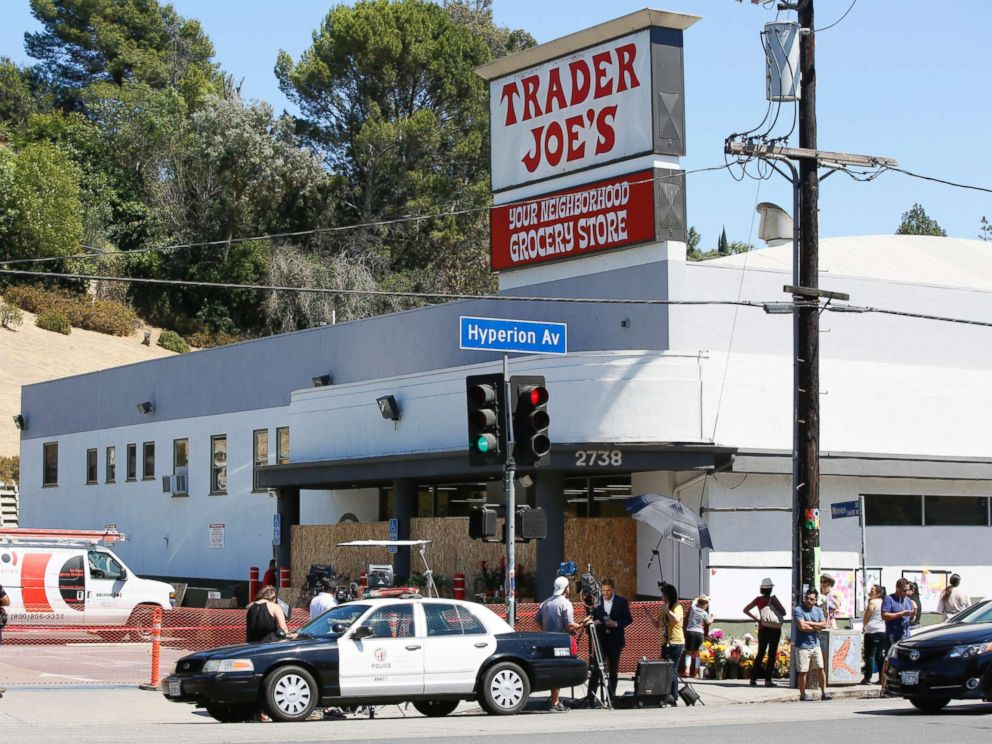 PHOTO: Police officers guard the entrance to the Trader Joes Los Feliz store, as it remains closed for business, July 22, 2018, in Los Angeles.