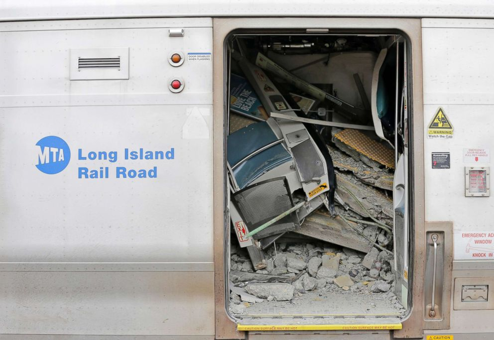 PHOTO: Debris is seen inside a train that derailed after striking a vehicle is seen in Westbury, N.Y., Feb. 27, 2019.