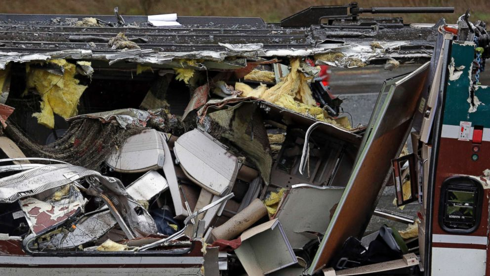 Seats are jammed together with other debris on an upside-down Amtrak train car sitting on a flat bed trailer taken from the scene of Monday's deadly crash onto Interstate 5, Dec. 19, 2017, in DuPont, Wash.