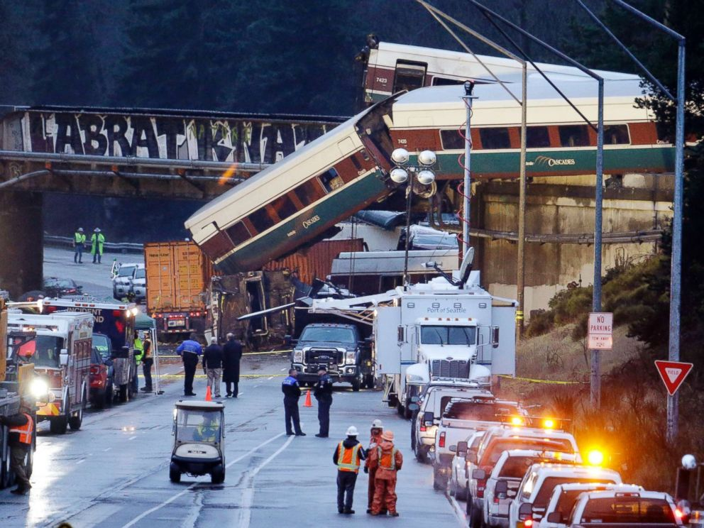 PHOTO: Lights illuminate cars from an Amtrak train that derailed above Interstate 5, Dec. 18, 2017, in DuPont, Wash.