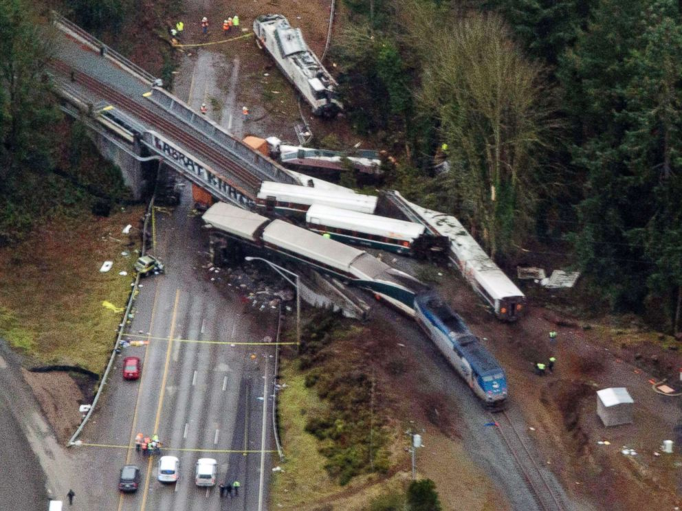 PHOTO: Cars from an Amtrak train that derailed spilled onto Interstate 5, Dec. 18, 2017, in DuPont, Wash. The Amtrak train making the first-ever run along a faster new route hurtled off the overpass near Tacoma.