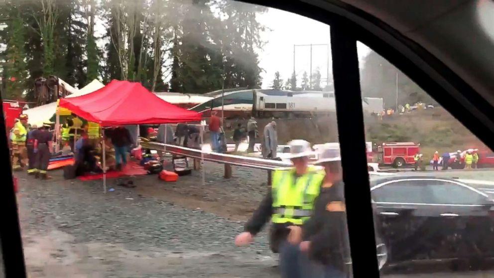 PHOTO: Emergency crews respond next to a derailed Amtrak train in Pierce County, Washington state, Dec. 18, 2017.