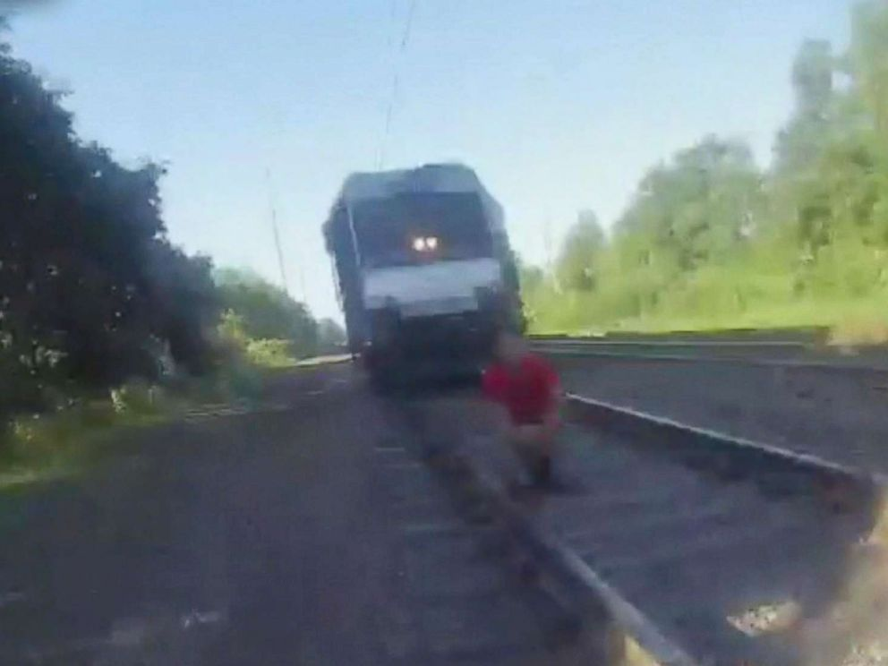 PHOTO: Perth Amboy Police Officer Kyle Savoias body camera captures footage of his life saving actions, July 19, 2018, as he saved a man who was just moments away from being struck by a moving train.