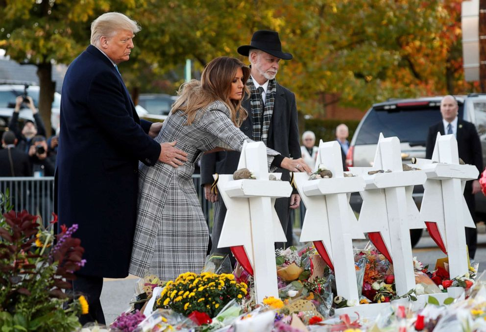 PHOTO: President Donald Trump and first lady Melania Trump place stones on a memorial to shooting victims as they stand with Tree of Life Synagogue Rabbi Jeffrey Myers outside the synagogue in Pittsburgh, Oct. 30, 2018.