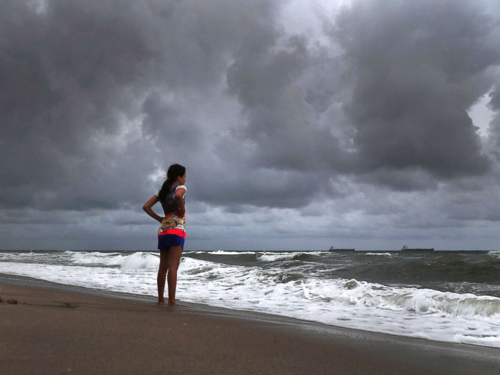 PHOTO: Alicia Herrera, 10, from Germany, does not let dark clouds ruin her day at the beach in Fort Lauderdale, Florida, May 25, 2018.